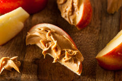 Organic Apples and Peanut Butter Stock Images