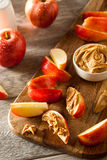 Organic Apples and Peanut Butter Stock Image