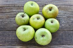 Organic apples on wooden background stock photo