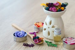Organic aroma oils. With herbal natural floral, dry flowers on wooden table - Spa set Stock Photography