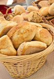 Organic Artisan  breads and rolls. In a wood wicker basket, for sale an an open air tropical farmers market Royalty Free Stock Photo