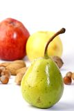 Organic Autumn Fruits. Apples, pear, almonds, hazelnuts and walnuts Stock Images