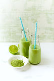 Organic avocado, cucumber and celery smoothie with barley grass Royalty Free Stock Image