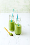 Organic avocado, cucumber and celery smoothie with barley grass Royalty Free Stock Photo