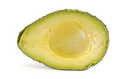 Organic Avocado cut in Half Stock Images