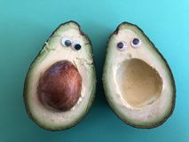 Creative healthy, fun food concept, avocado with google eyes stock image