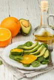 Organic avocado and spinach salad with orange Royalty Free Stock Photo