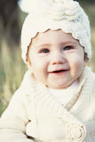 Organic baby. Little baby girl smiling and so happy all organic Stock Image