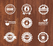 Organic Badges on a Wood Texture Royalty Free Stock Photo