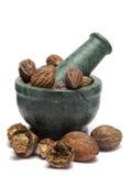 Organic Badi Harad fruit  (Terminalia chebula) on marble pestle Stock Images