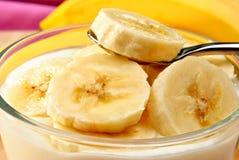 organic banana slices with natural yoghurt stock photography