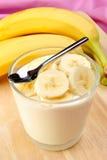 organic banana slices with natural yoghurt Royalty Free Stock Photo