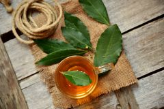Organic bay leaves tea on a vintage wooden table Royalty Free Stock Photo