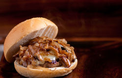 Organic beef burger with cheese, onions and mushrooms Stock Photography