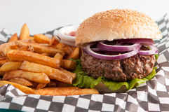 Organic beef burger and fresh french fries Royalty Free Stock Photo