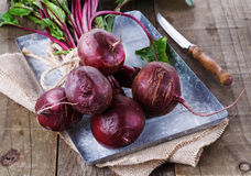 Organic beetroot over rustic wooden background Royalty Free Stock Images