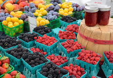 Organic Berries and Plums Stock Photos