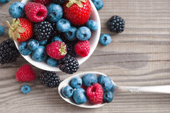 Organic berries on wooden table. Royalty Free Stock Photo