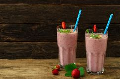 Organic berry smoothie with oatmeal on a dark background stock photos