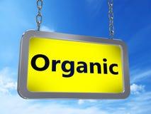 Organic on billboard. Organic on yellow light box billboard on blue sky background Royalty Free Stock Photo