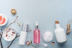 Organic bio cosmetics with herbal ingredients. Natural extract of rose, oils, serum. Copy Space, flat lay, Handmade stock photography