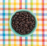 Organic black beans in a bowl on a place mat Royalty Free Stock Images