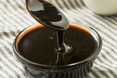 Organic Black Cane Sugar Molasses. In a Bowl royalty free stock photography