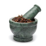 Organic black clove (Syzygium aromaticum) on marble pestle. Stock Photos