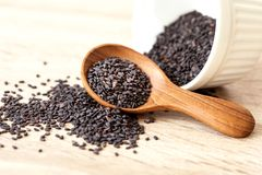 Organic Black sesame seeds in a wooden spoon ,healthy food for royalty free stock image