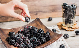 Organic blackberries in a glass on a wooden plate, rustic. Clean Stock Photos