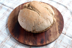 Organic bread. On a a wooden desk royalty free stock photo