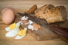Organic breakfast, crispy baguette and eggs Stock Photography