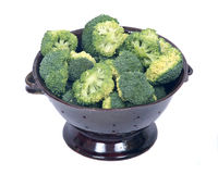 Organic broccoli in berry bowl. On white background Stock Image