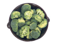 Organic broccoli in berry bowl. On white background Royalty Free Stock Photos
