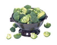 Organic broccoli in berry bowl. On white background Royalty Free Stock Images
