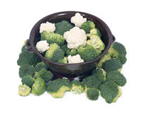 Organic broccoli and cauliflower in berry bowl. On white background Royalty Free Stock Image