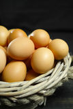 Organic brouw chicken eggs from free-range farm. In wicked basket royalty free stock images