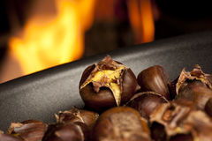 Organic Brown Chestnuts Roasting Stock Images