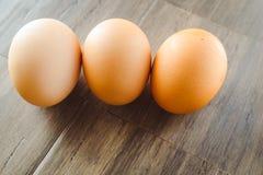 Organic Brown Eggs on Bamboo Wood. Farm fresh organic brown hen eggs on wooden gray bamboo Stock Image