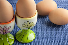 Organic brown eggs in eggcups Royalty Free Stock Photos