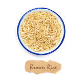 The  organic brown rice in cup with name tag on white background Stock Photos