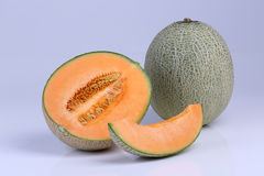 Organic Cantaloupe melon fruit isolated on white background Royalty Free Stock Images