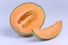 Organic Cantaloupe melon fruit isolated on white background Stock Photo