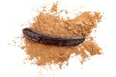 Carob powder and beans. Organic carob bean and carob powder from above Royalty Free Stock Images