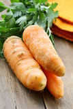Organic carrot with green leaves Stock Photo