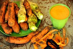 Organic carrots and carrot juice for a healthy breakfast Royalty Free Stock Photo