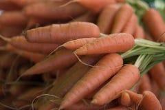 Organic Carrots at a Farmers Market. Organic Bunches of carrots at a Farmers Market in summer in California Stock Photo