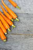 Organic carrots on a wooden background Royalty Free Stock Images