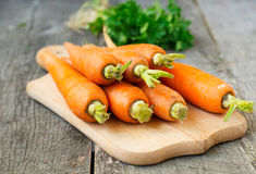 Organic carrots on a wooden background Royalty Free Stock Image