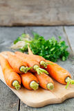 Organic carrots on a wooden background Royalty Free Stock Photography